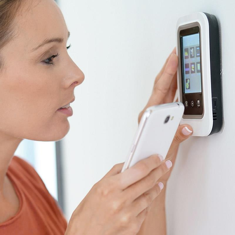 woman with a thermostat