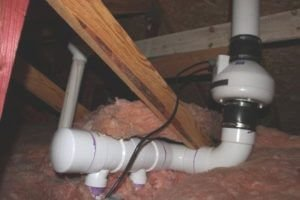 radon mitigation fan in the attic
